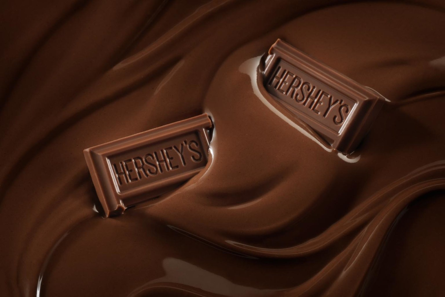 Hershey's chocolate bars in pool of chocolate after digital retouching