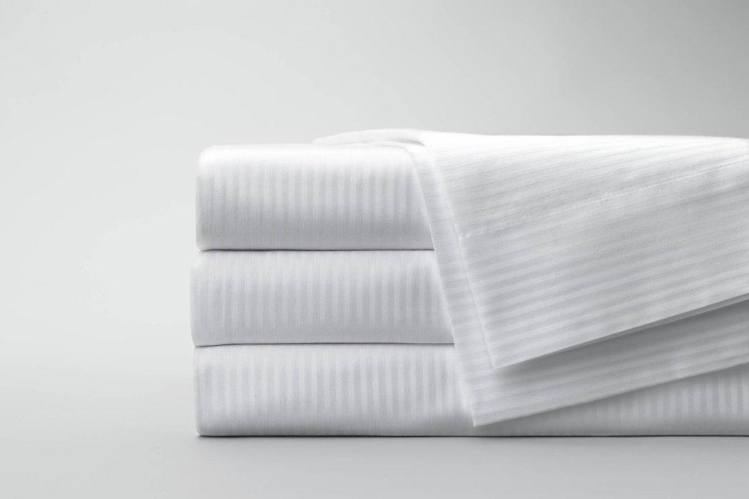 Folded stack of white textile fabrics
