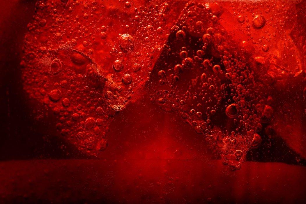 A bubbling splash of red liquid