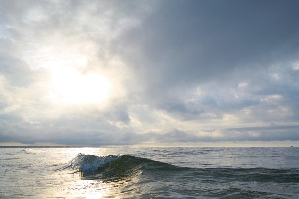 Ocean wave with the sun