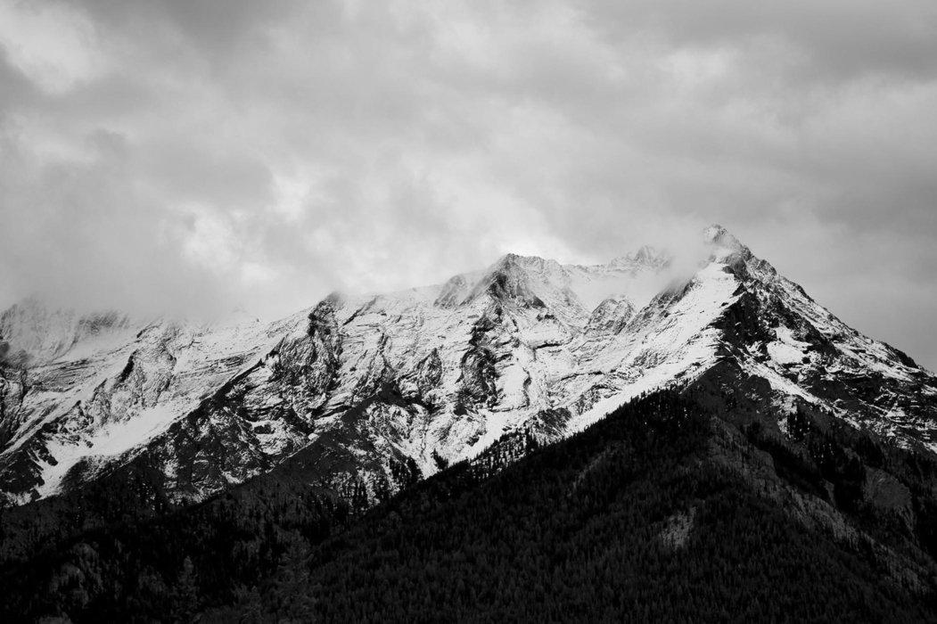 Dark mountain peaks with snow
