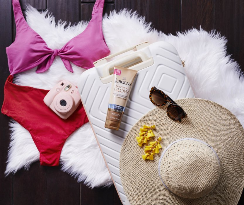 Cosmetics products laid out for a day at the beach - Product phtoography