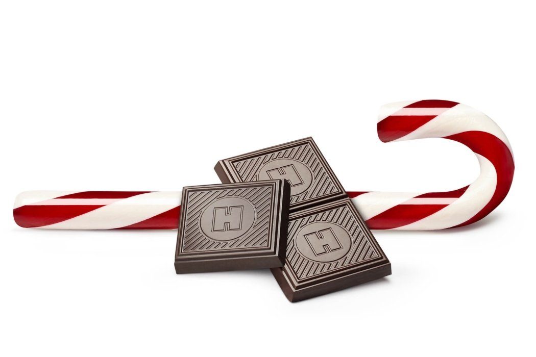 Candy photography - Three chocolate bars and a candy cane