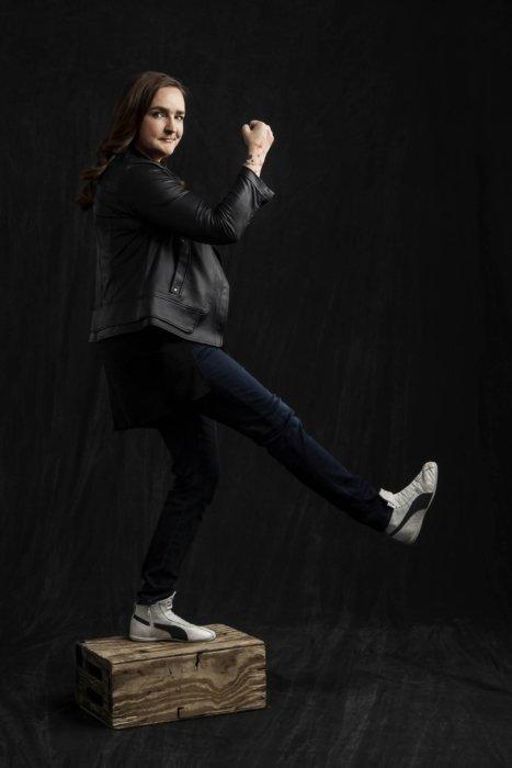 Portrait of Tina Roth Eisenberg on a dark cloth background