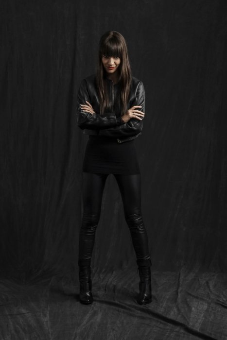 Portrait of Jessica Walsh on a dark cloth background