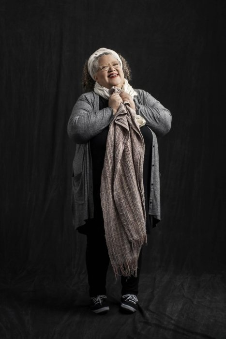 Portrait of Gail Anderson on a dark cloth background