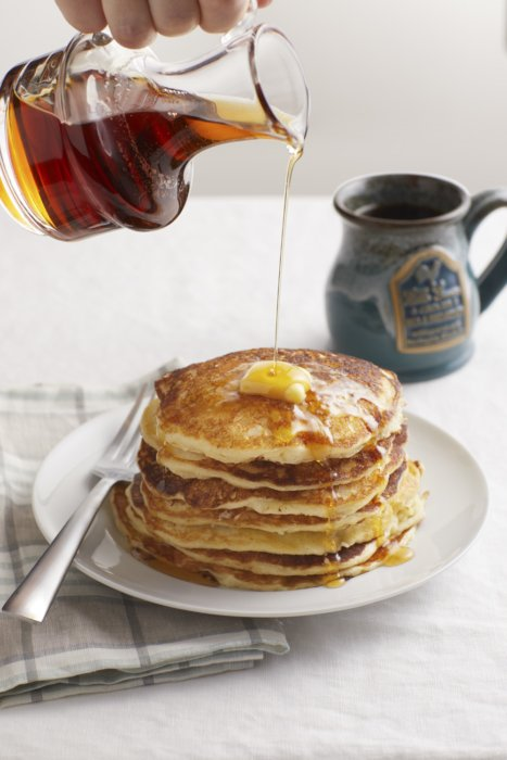A perfectly stacked pancake with syrup drizzle - Food Styling