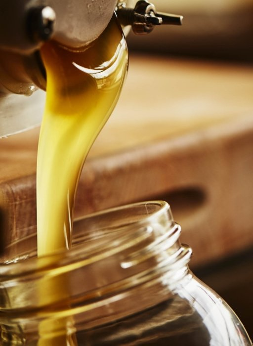 Farm to table - pouring honey