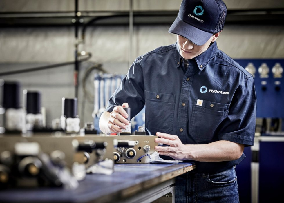 A man inspecting electronic special industrial equipment alternative - industrial photography