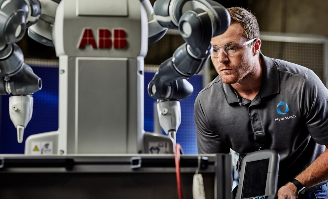 A man inspecting robotic industrial equipment - industrial photography