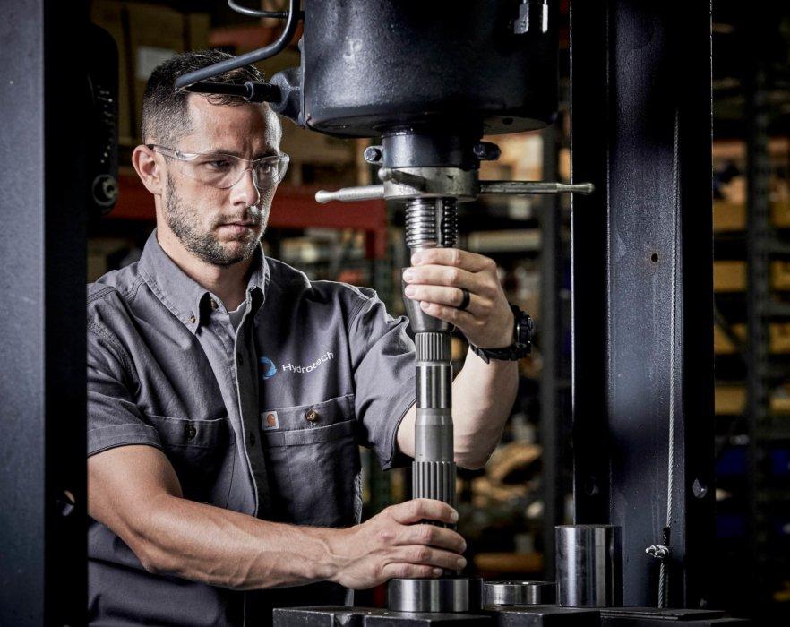 Man working on machine Hrydotech workplace photography