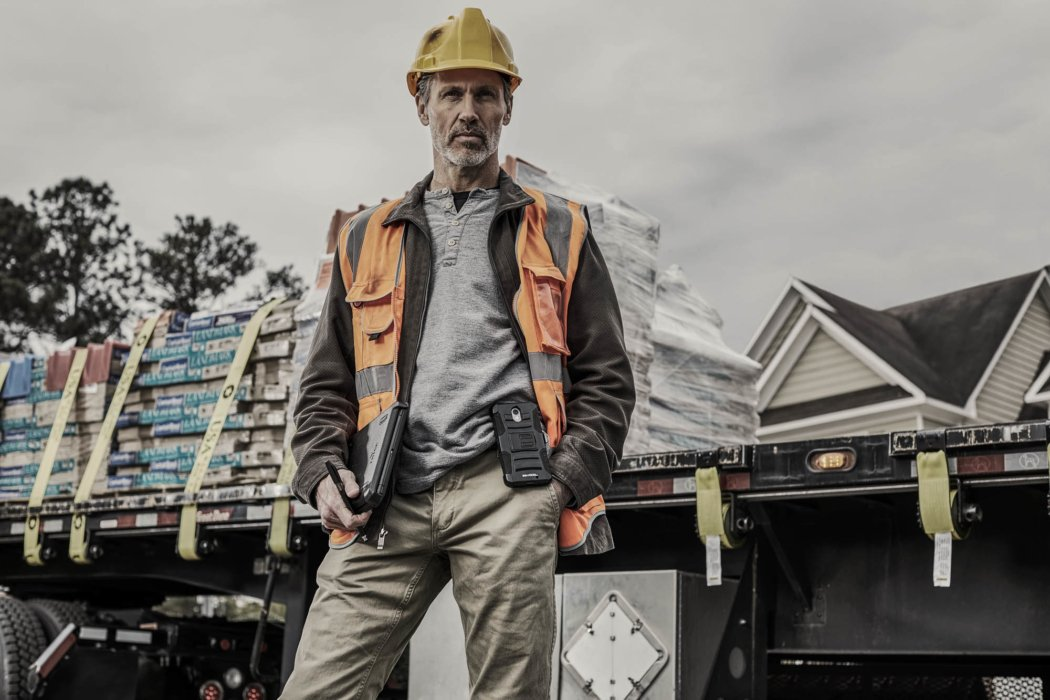 A man looking serious at a job site - work photography
