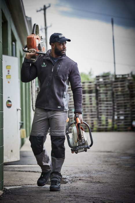 A man walking with equipment - work apparel photography
