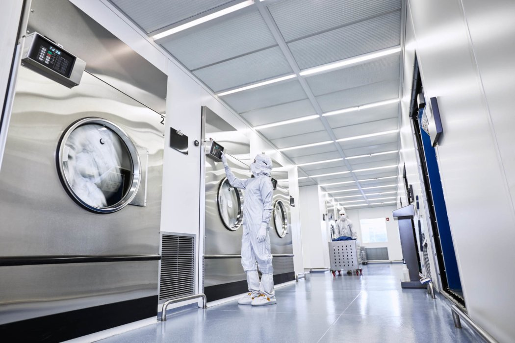 Workers in sterile environment wearing full body suits - work apparel photography