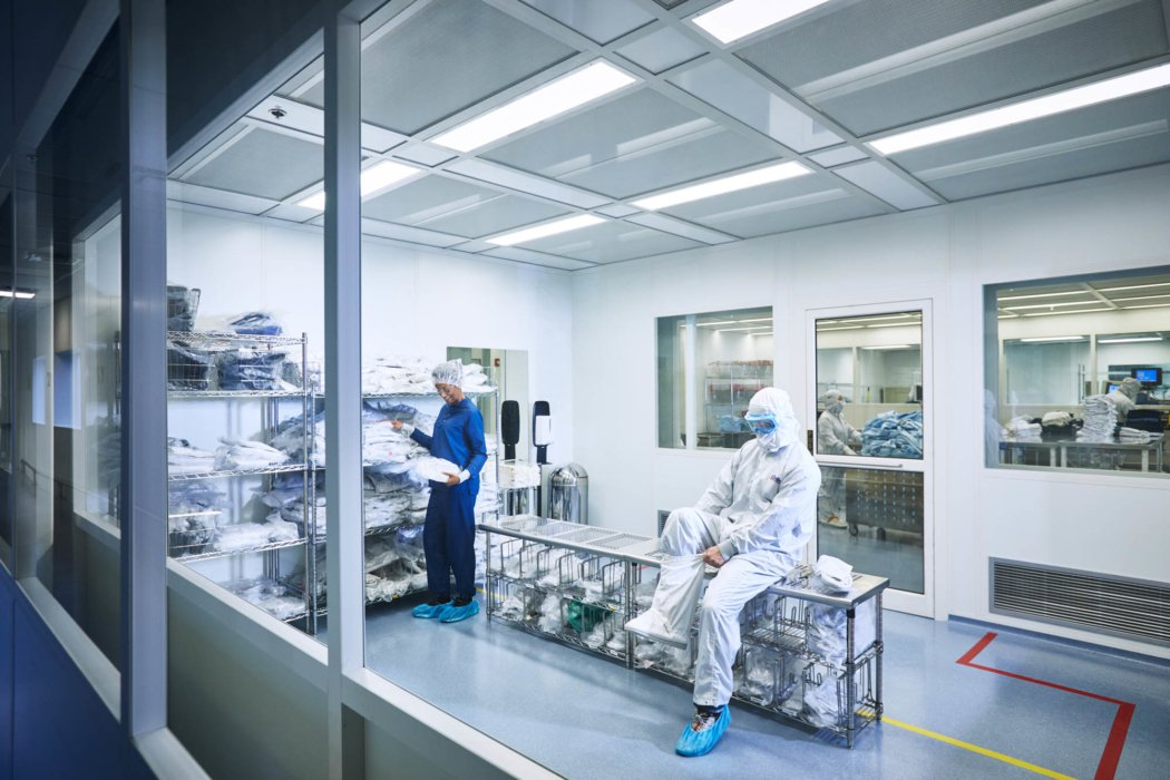 Workers getting on sterile work environment clothes - work apparel photography