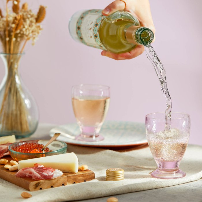 Ava grace wine pour into a pink glass