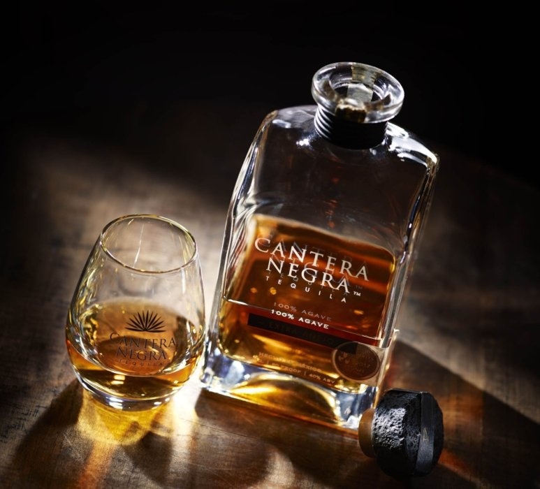 Extra anejo tequila on a dark wood look - cantera negra - drink photography