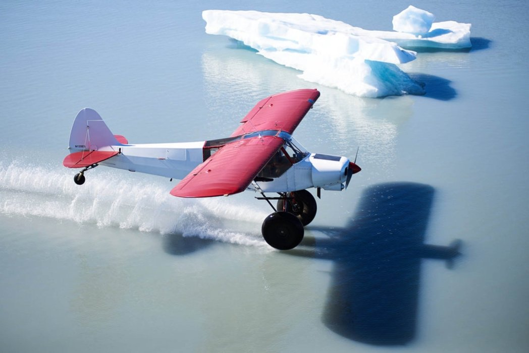 A prop plane skirting on an an icy ocean