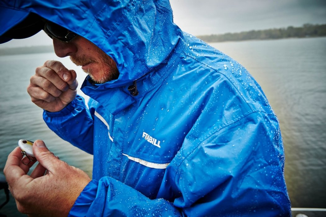 A fisherman working on a bait wearing a frabill coat