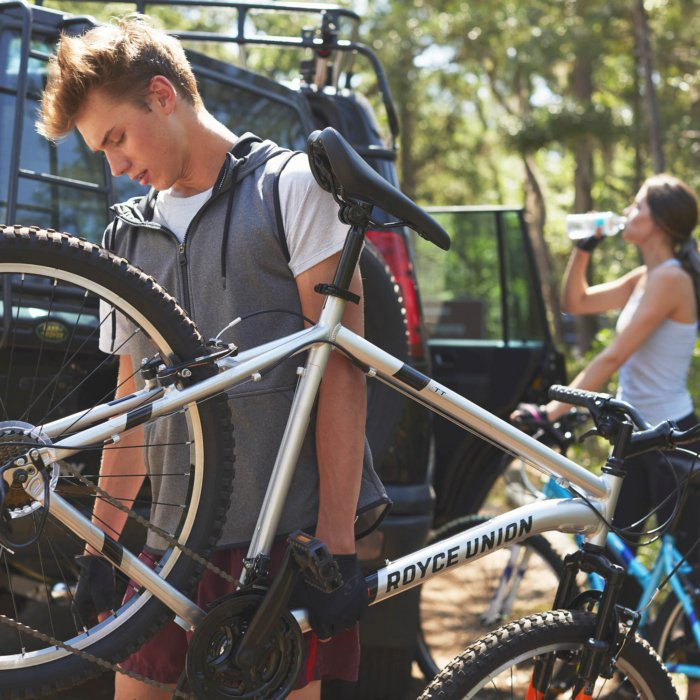 A cyclist holding a royce union bike