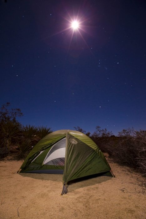 A camping tent in the desert at night