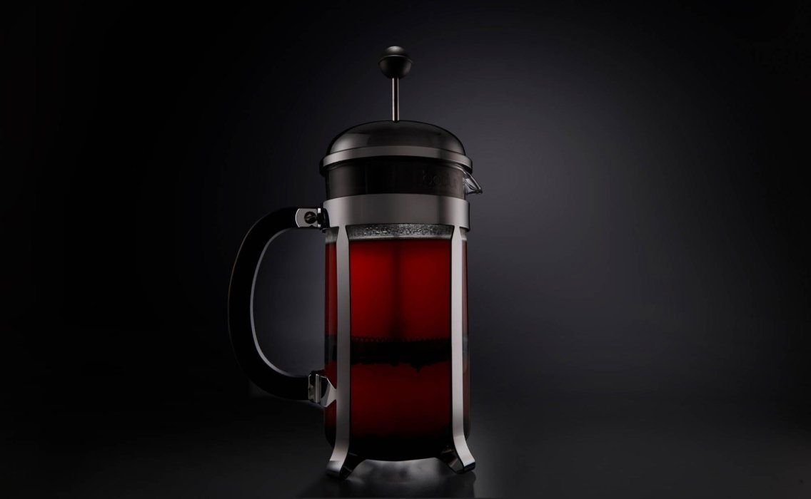 A french press with coffee brewing today
