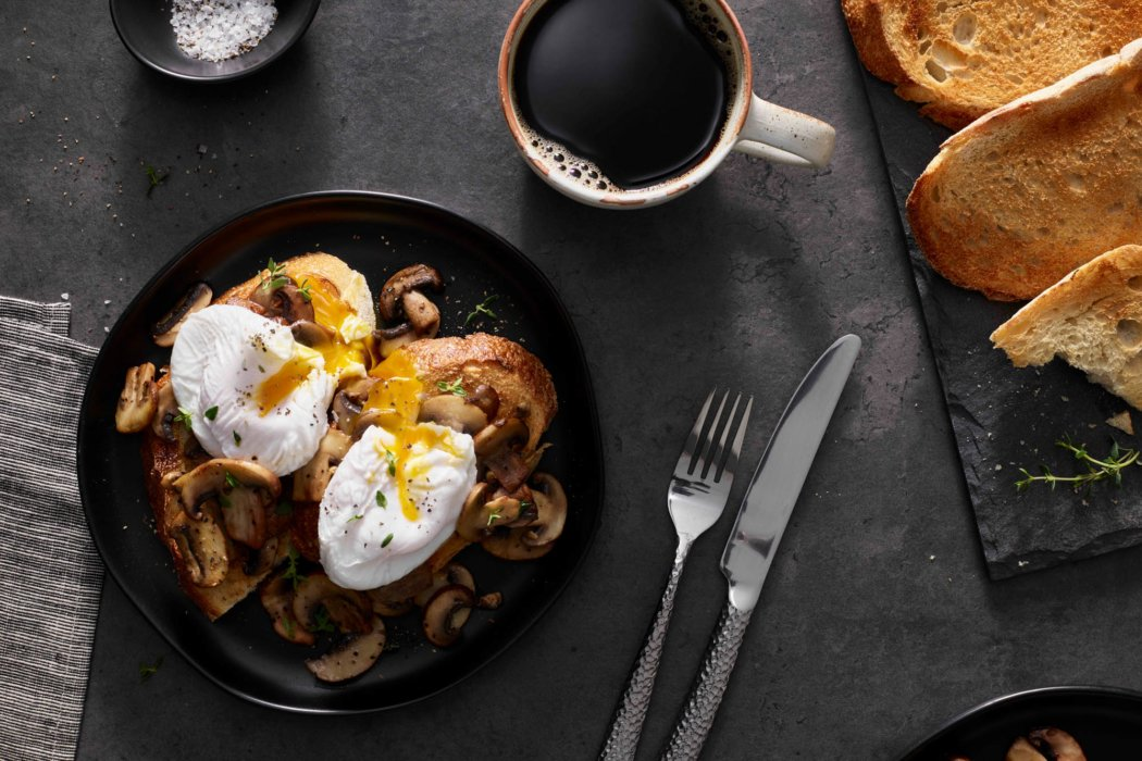 A coffee toast and poached egg breakfast savory