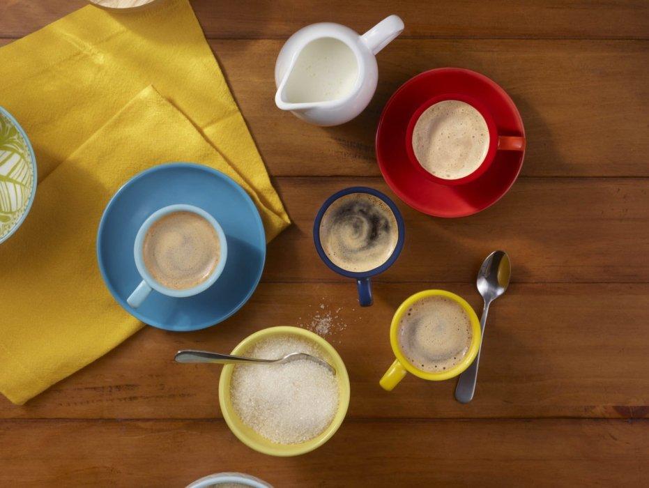 Multiple espresso cups with espresso and sugar and cream