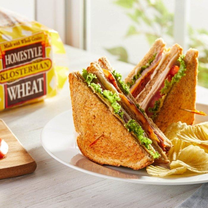 homestyle wheat bread food Turkey club sandwich side of potatoes chips