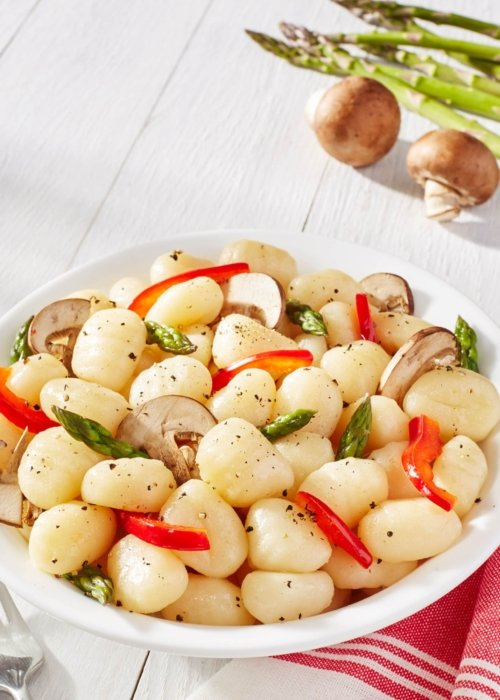 fresh food vegetables in a white bowl asparagus and mushrooms