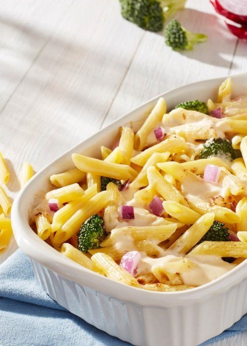 white ceramic bowl with fresh cooked food pasta with green broccoli