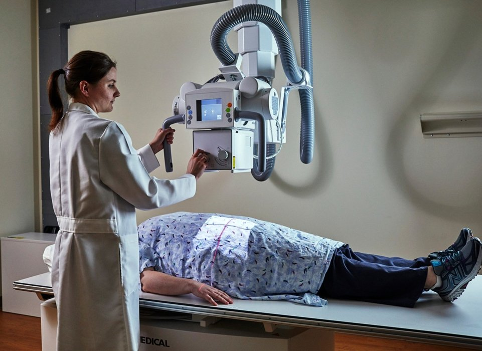 doctor using medical equipment on patient in healthcare