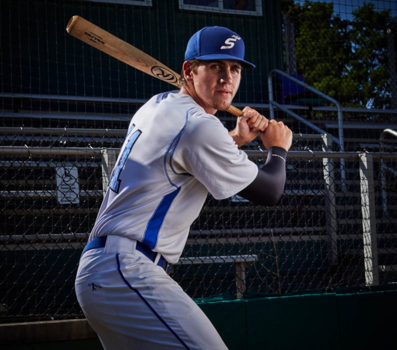 Portrait of a young base ball player with a bat
