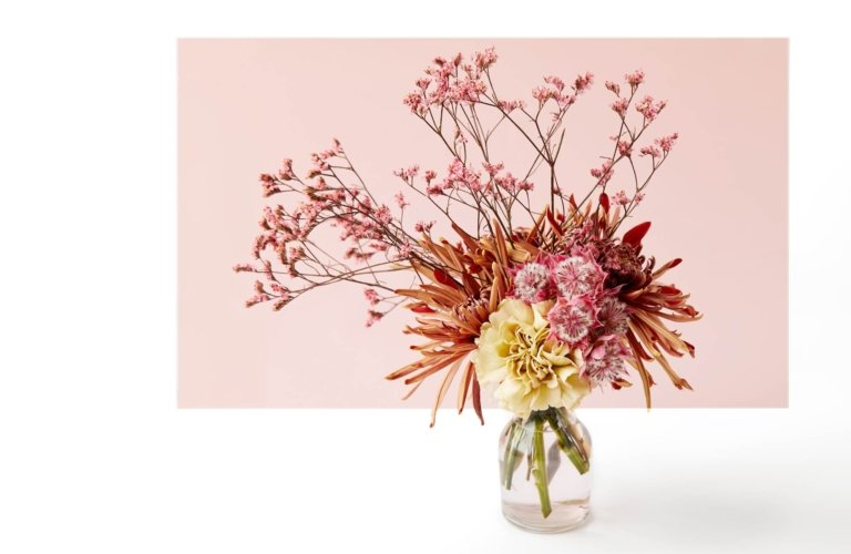 Beautiful pink and yellow flower vase with orange and flowers