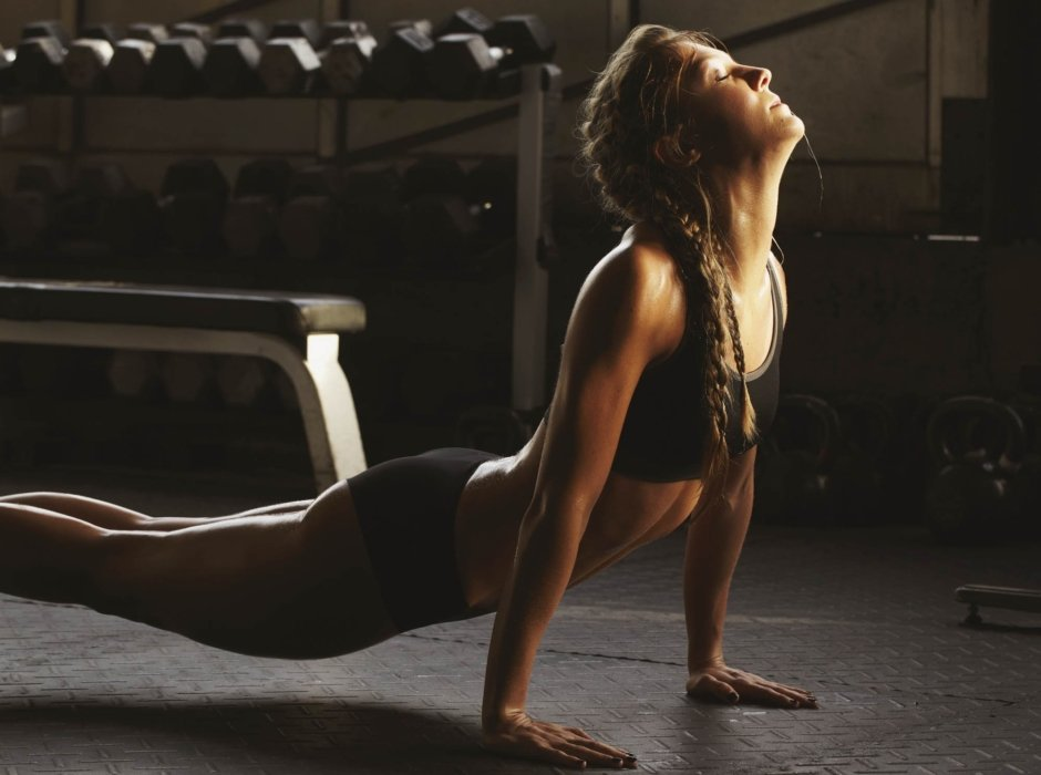 A young woman stretching and doing yoga before a workout