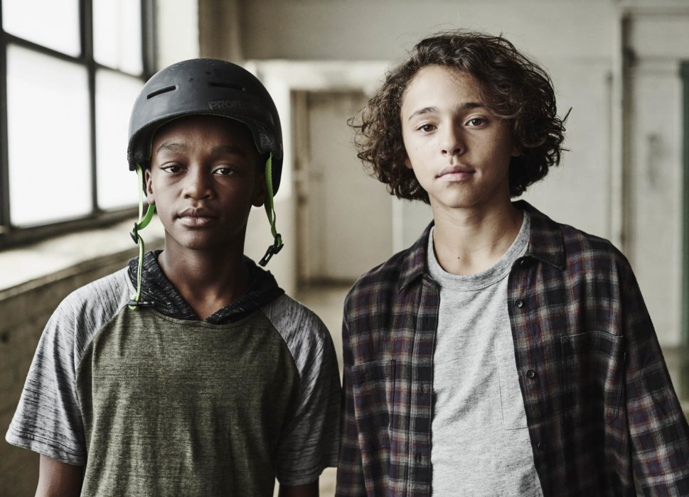 Two young boys portrait while wearing sports gear