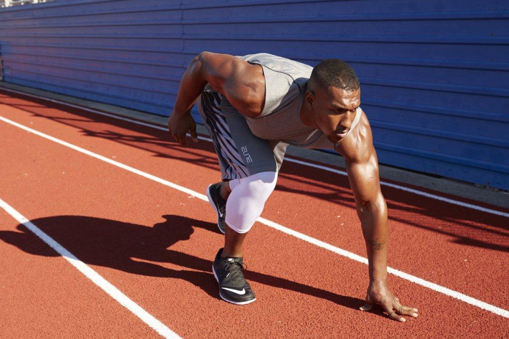 A man doing endurance training on a track