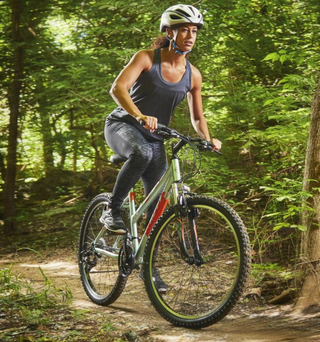 A cyclists riding on a trail in the woods for sport