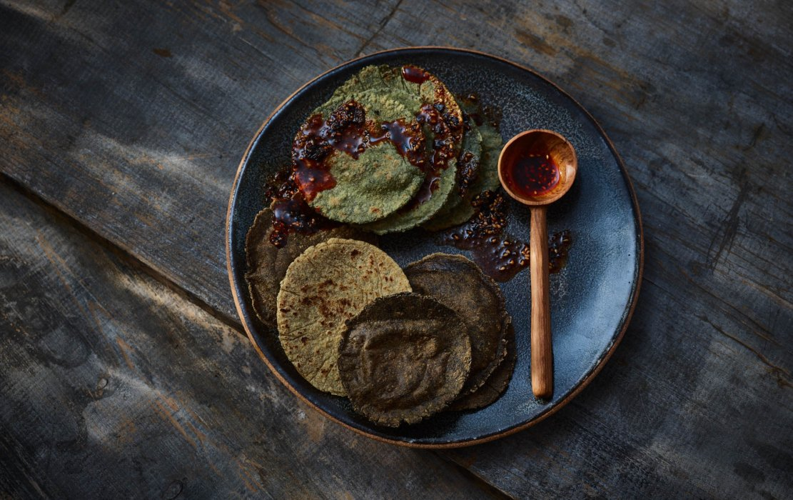 Mexico inspired editorial food photography - raw foods and veggies with tortilla and spoon