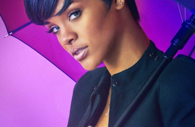 Portrait of the singer Rihanna holding a modern umbrella