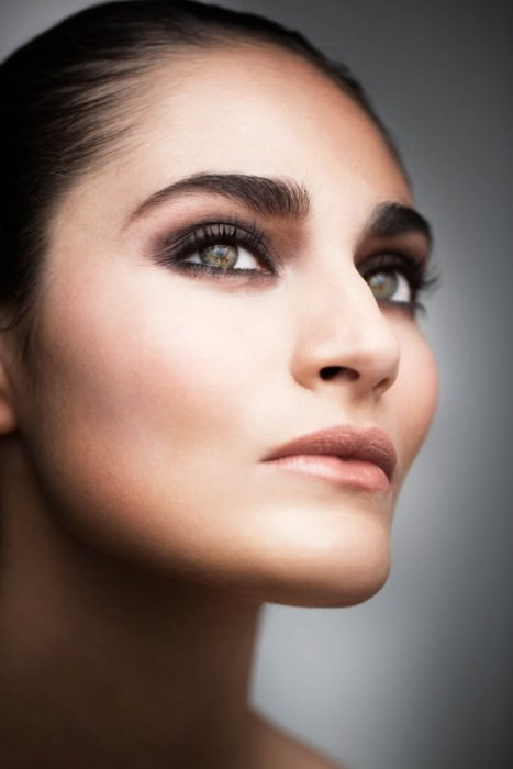 Beauty shot of a woman's face close up on cheeks and eyes.