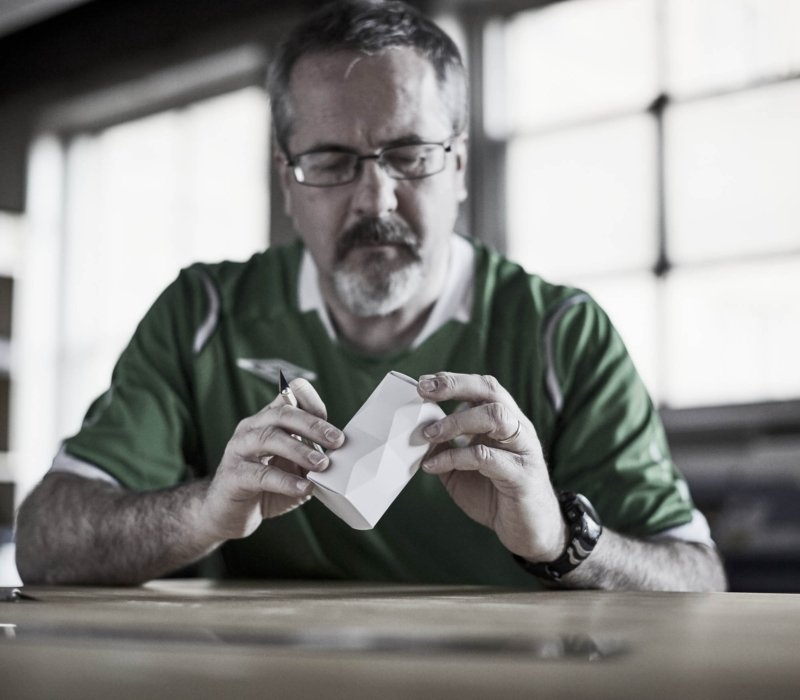 A worker at an industrial design workplace inspecting a 3d object