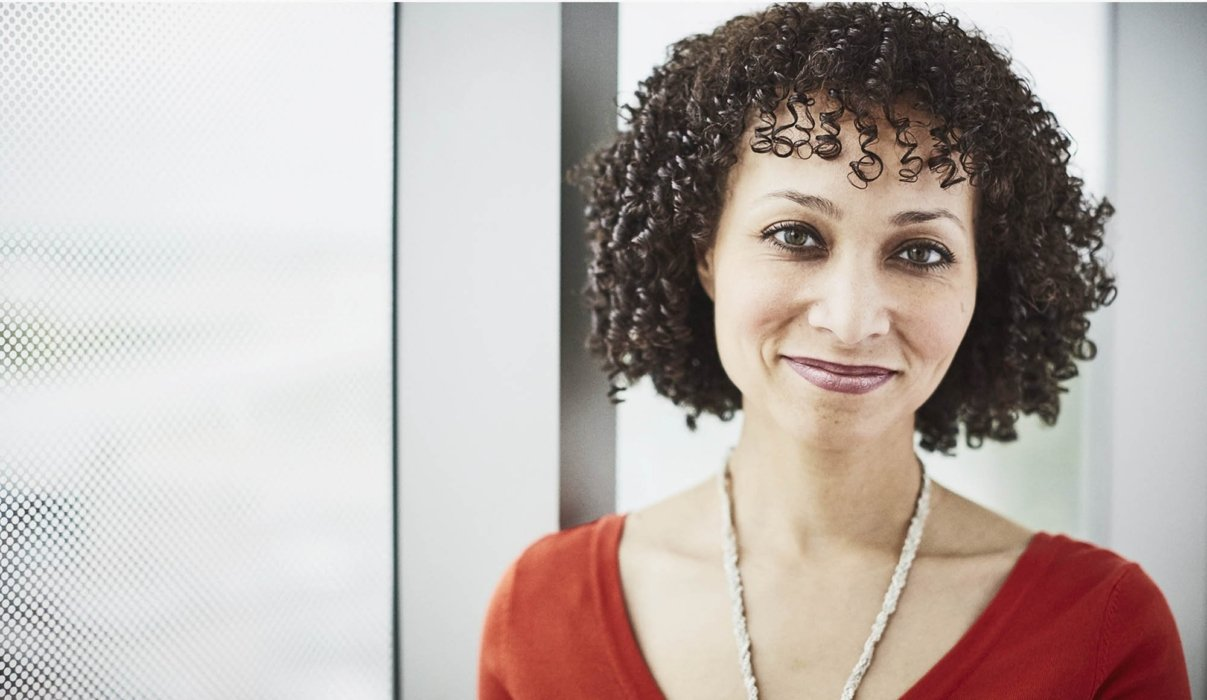 A woman smiling in a corporate setting