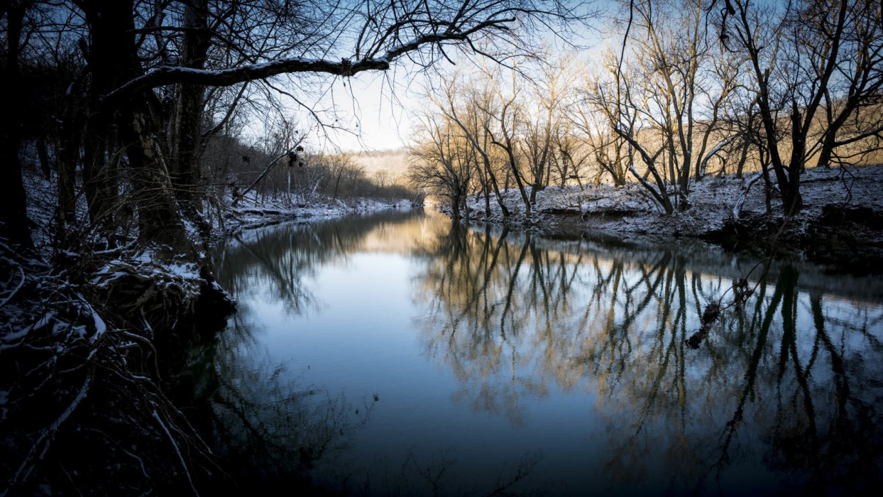 A river in the middle of winter with snowy banks - Nature Photography