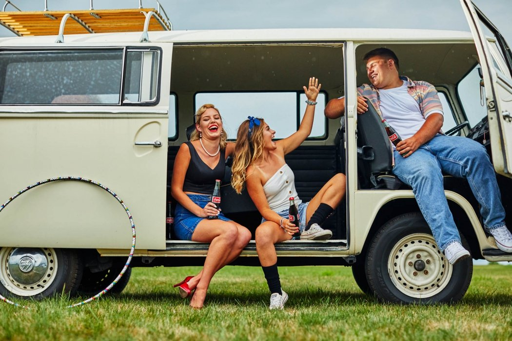 Group of friends in a vintage van - lifestyle photography