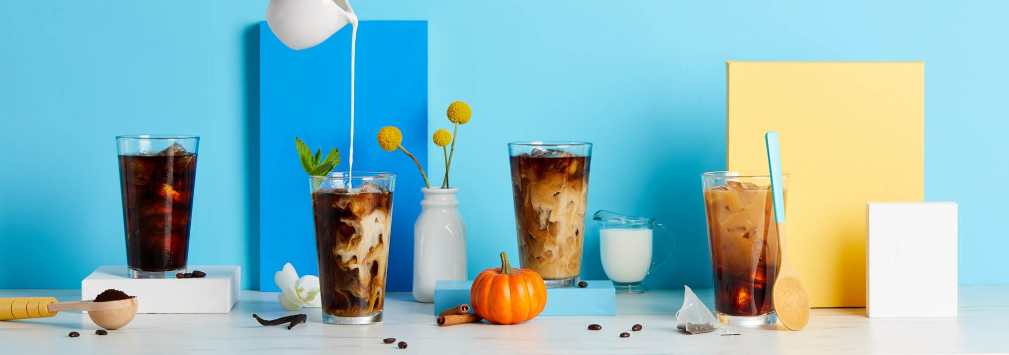 Different stages of creamy iced coffee - drink photography