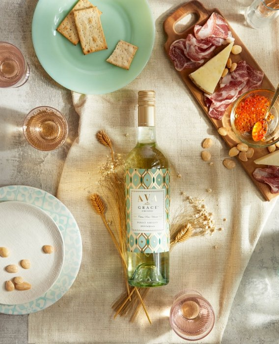 Wine product photography of Ava grace wines rose with cheese plate and olives