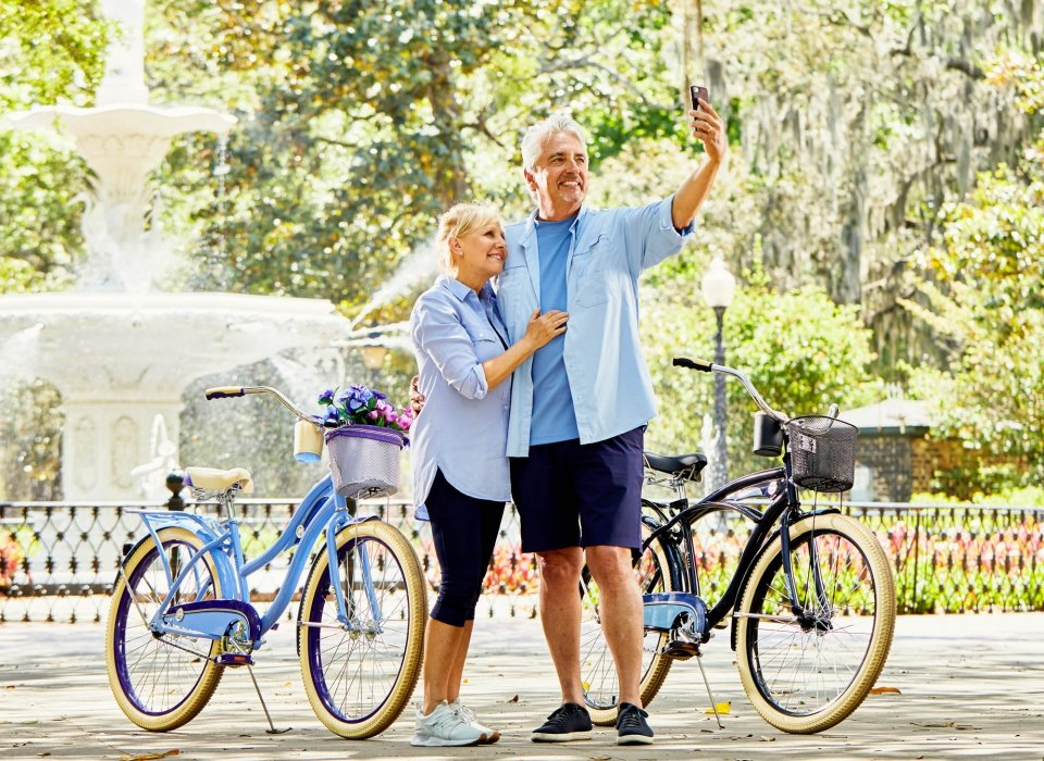 An middle aged couple taking a selfie by bikes - lifestyle photography