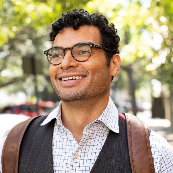 Portrait of a man smiling wearing hipster cloths - lifestyle photography