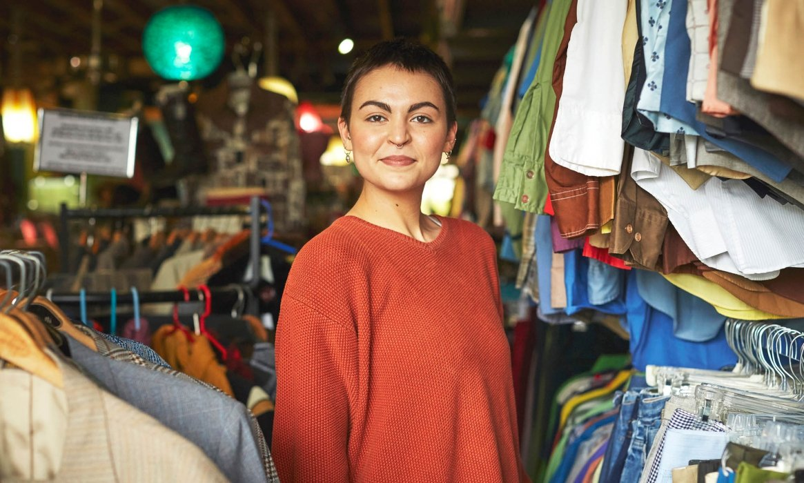 Portrait of a young woman in a clothing store